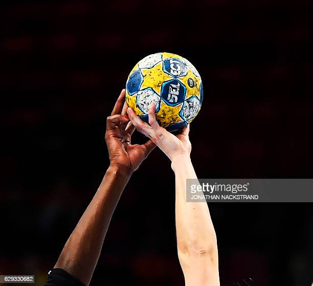 The hands of Spain's Alexandrina Cabral and Germany's Anna Loerper reach to grab the ball during the Women's European Handball Championship Group I...
