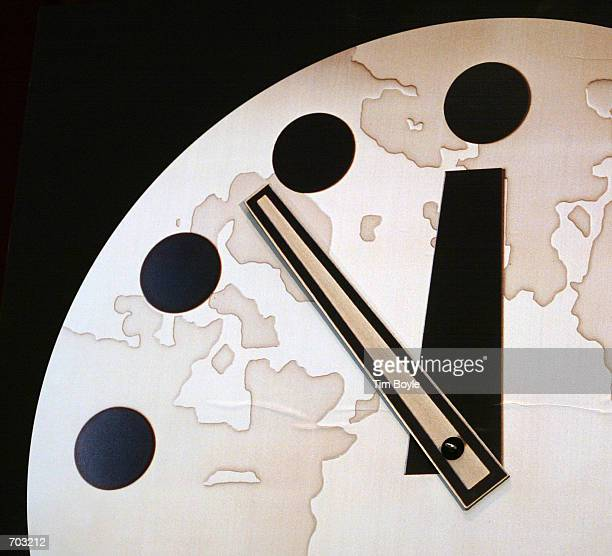 The hands of the Bulletin of the Atomic Scientists Doomsday Clock are seen at 1153 pm two minutes closer to midnight displayed February 27 2002 at...