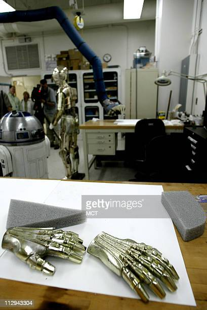 The hands of the costume for C3PO from Star Wars Return of the Jedi lay on a table during restoration at the Smithsonian Institution's National...