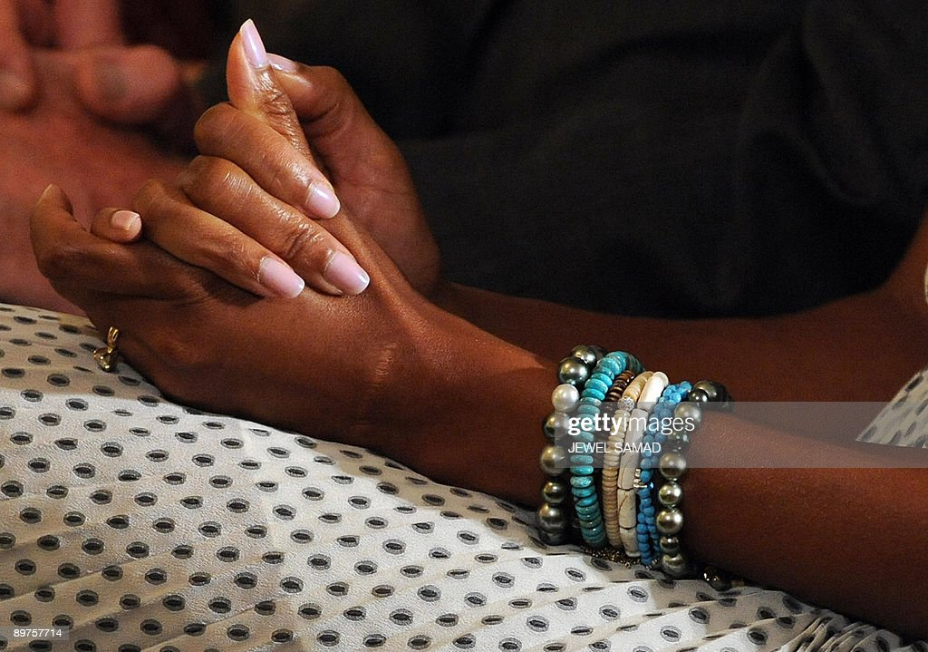 The hands of US First Lady Michelle Obama are pictured as she listens to President Barack Obama speaking during a reception for Justice Sonia Sotomayor in the East Room at the White House on August 12, 2009 in Washington,DC. Sotomayor was sworn in on August 8 in a public ceremony as a US Supreme Court justice, becoming the first Hispanic justice on the nation's highest bench. AFP PHOTO/Jewel SAMAD