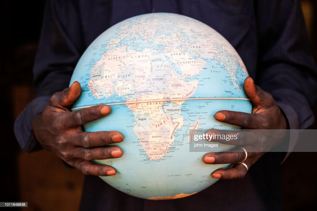 The hands that holds the world : Stock Photo