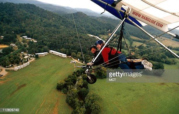 The hang glider looks much like an oversized kite as Mary Ann Anderson and instructor Eric Graper soar high above the valleys of Lookout Mountain