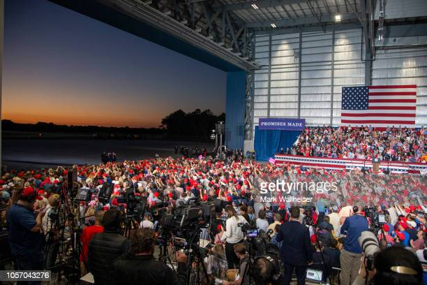 The hanger doors open as supporters wait for the arrival of Air Force One and U.S. President Donald Trump at a campaign rally at the Pensacola...