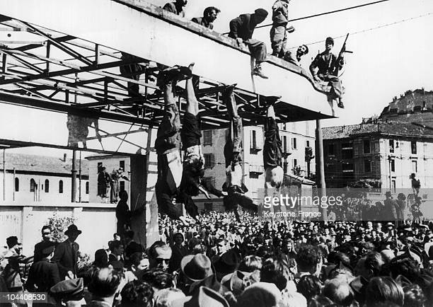 The hanging of MUSSOLINI's body and that of his mistress' Clara PETRACCI on gruesome display in May 1945 The authorities permit this event seeing it...