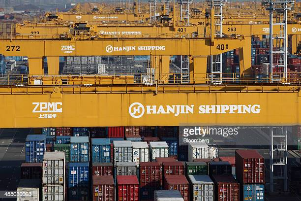 The Hanjin Shipping Co logo is displayed on cranes at the company's Busan New Port terminal in Busan South Korea on Tuesday Dec 10 2013 South Korea's...