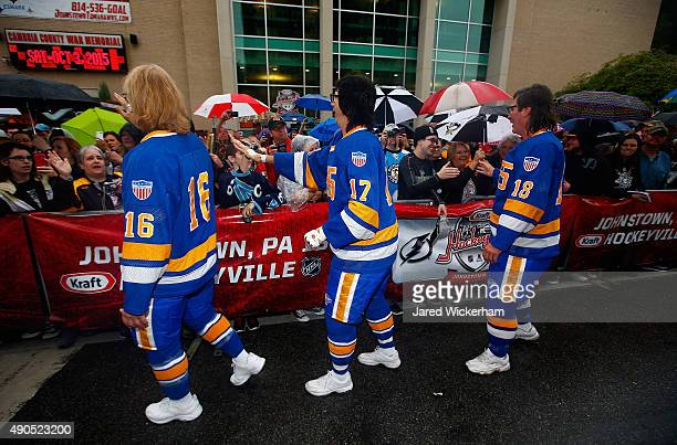 The Hanson Brothers Dave Hanson Steve Carlson and Jeff Carlson greet fans outside the Cambria County War Memorial Arena before the Pittsburgh...
