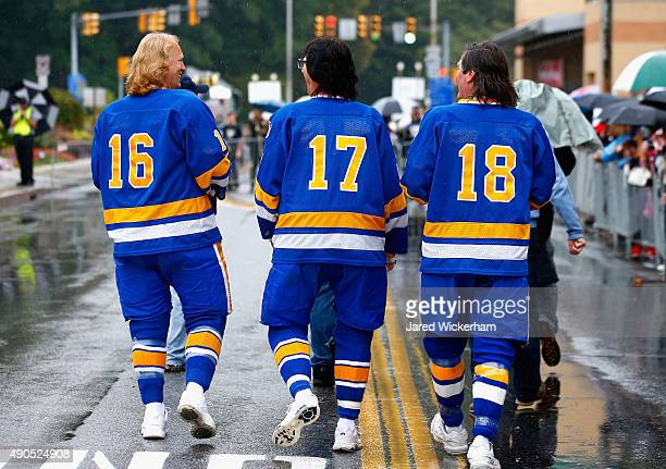 The Hanson Brothers Dave Hanson Steve Carlson and Jeff Carlson walk down the street after greeting fans outside the Cambria County War Memorial Arena...