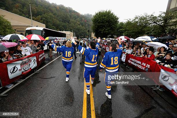 The Hanson Brothers Dave Hanson Steve Carlson and Jeff Carlson walk down the street greeting fans outside the Cambria County War Memorial Arena...