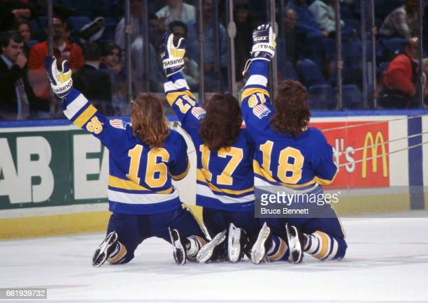 The Hanson Brothers from the movie Slapshot Jack Hanson Steve Hanson and Jeff Hanson slide on the ice and wave to the crowd before a New York...