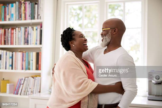 the happiest homes are filled with lots of laughter - mature couple stock pictures, royalty-free photos & images