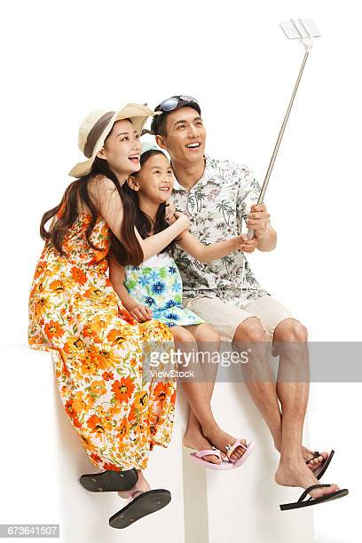 The happiness of a family of three with mobile phone self timer