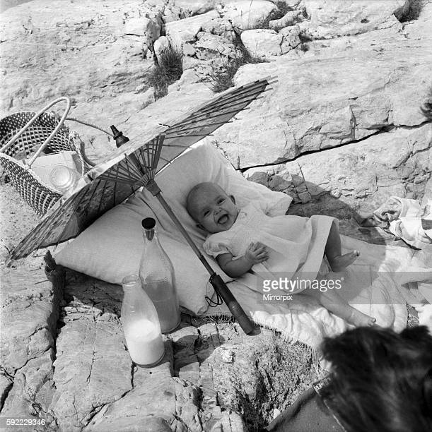 The happy baby is 4 months old Beverley Lovelock whose mummy of the Parade Plymouth took her for a beach picnic June 1960 M4272001