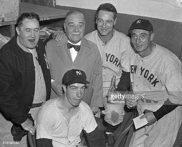 The happy scene in the dressing room of the New York Yankees at the Polo Grounds New York City October 8th after the Yankees beat the Giants 42 to...