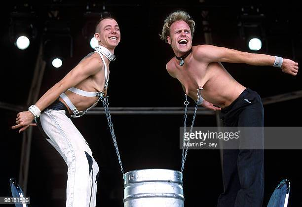 The Happy Side Show lift a keg of beer with their nipple piercings at Livid Music Festival on 19th October 2002 in Melbourne Australia