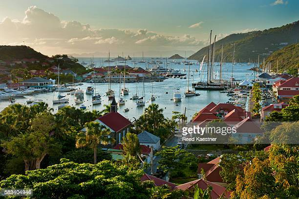 The harbor of Gustavia,  Saint-Barthélemy at twilight filled with sail boats.