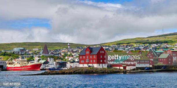 the harbor of torshavn along tinganes peninsula, the historical core of the country's capital. - torshavn stock pictures, royalty-free photos & images
