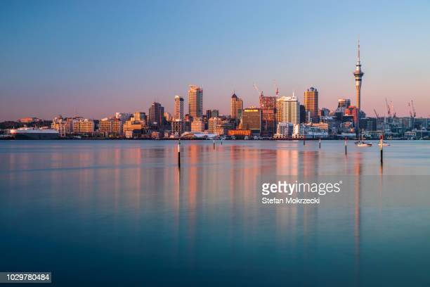 the harbour and central city buildings of auckland, new zealand viewed from the north shore. - waitemata harbor stock photos and pictures
