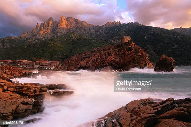 The harbour and Genoese tower with Capo d'Orto beyond., Porto, Corsica, France, Europe