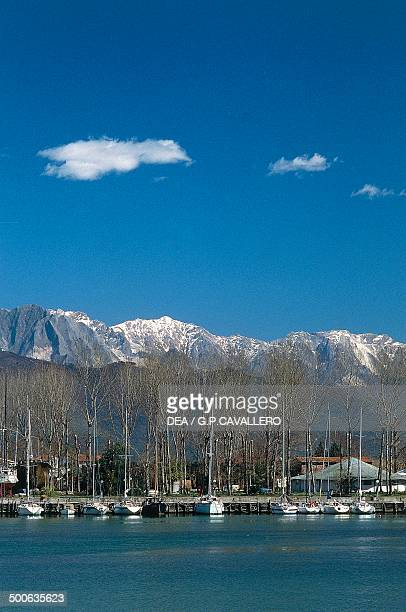 The harbour at Bocca di Magra with the Apuan Alps in the background Liguria Italy