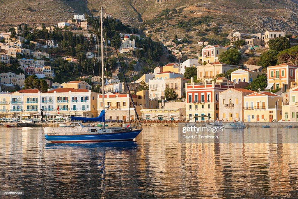 The harbour at sunrise, Gialos, Symi, Greece : Foto stock