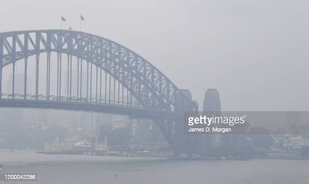 The Harbour Bridge is surorunded by smoke during rain showers on January 17 2020 in Sydney Australia A severe thunderstorm warning has been issued...