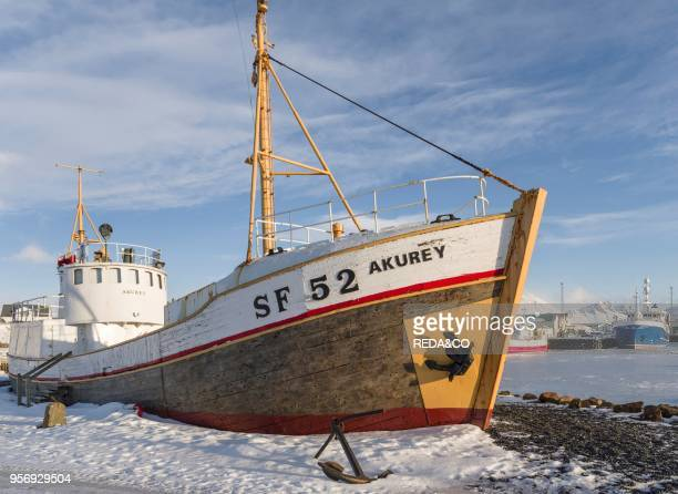 The harbour of the small town Hoefn during winter Museumsship in the harbour europe northern europe Iceland February