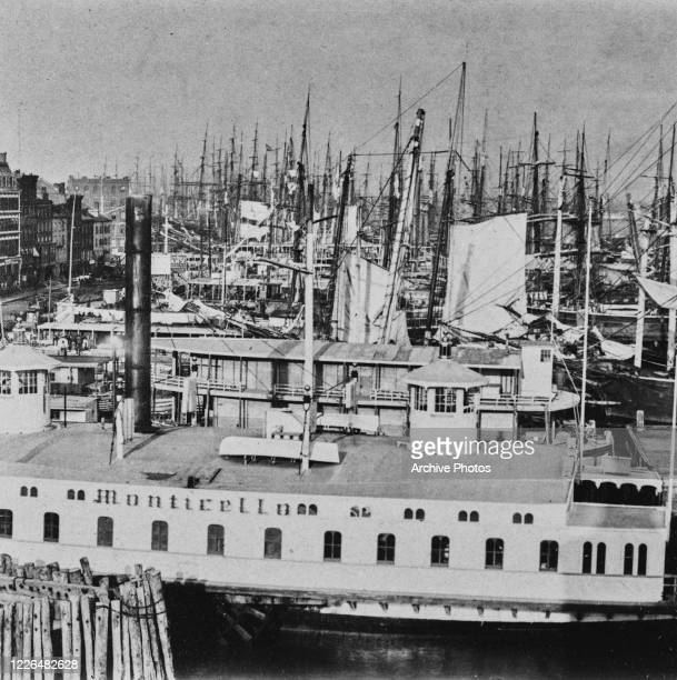 The harbour on the East River in New York City, with the 'Monticello' in the foreground, circa 1880.