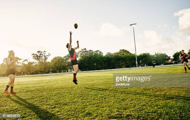 the harder you work, the harder it is to lose - afl stock pictures, royalty-free photos & images