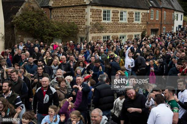 The hare pie is thrown to the crowd after being carried through the village on April 17 2017 in Hallaton England Hallaton hosts the Hare Pie Scramble...
