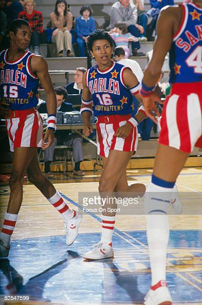 The Harlem Globetrotters' Lynette Woodard runs onto the court with her teammates during a game