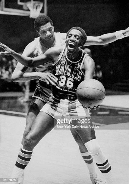 The Harlem Globetrotters' Meadowlark Lemon and New Jersey Reds' General Holman during a game at Madison Square Garden