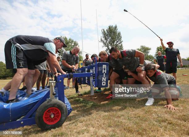 The Harlequins Forwards Coach Alex Codling watches as the forwards scrummage during a Harlequins training session at Surrey Sports Park on July 19...