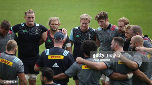 The Harlequins forwards form a huddle during the captain's run at Twickenham Stoop on September 14 2018 in London England