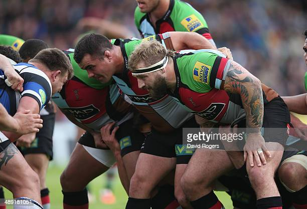 The Harlequins front row Kyle Sinckler Dave Ward and Joe Marler scrummage during the Aviva Premiership match between Harlequins and Bath at the...