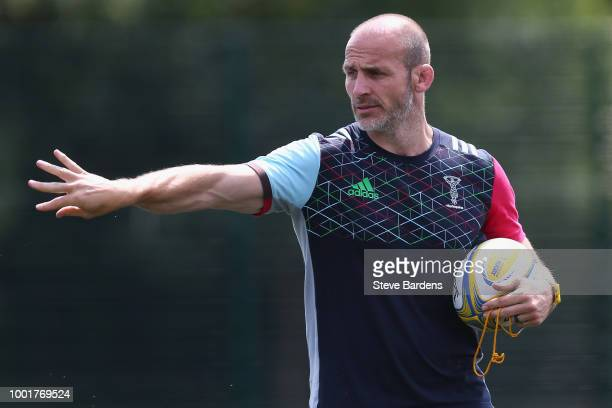 Ben Tapuai of Harlequins passes the ball during a Harlequins training session at Surrey Sports Park on July 19 2018 in Guildford England