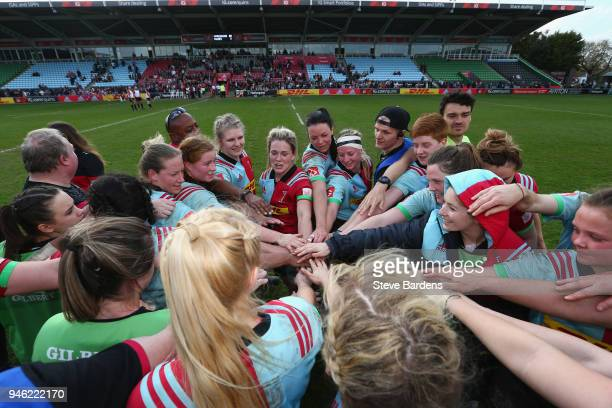 The Harlequins Ladies players form a huddle after their victory over Wasps FC Ladies during the Tyrrells Premier 15s Semi Final 2nd Leg match between...