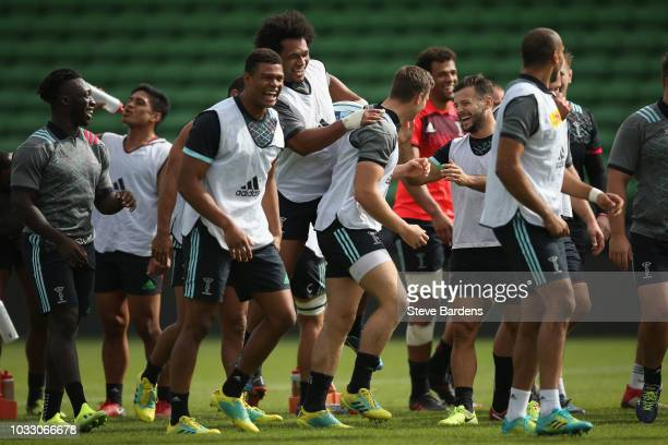 The Harlequins players enjoy a joke during a the captain's run at Twickenham Stoop on September 14 2018 in London England