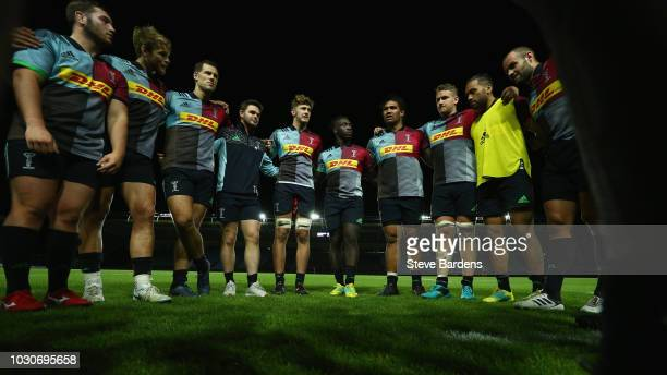 The Harlequins players form a huddle after the Premiership Rugby Shield match between Harlequins and Bristol United at Twickenham Stoop on September...