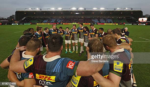 The Harlequins players form a team huddle after their victory in the Aviva Premiership match between Harlequins and Worcester Warriors at Twickenham...