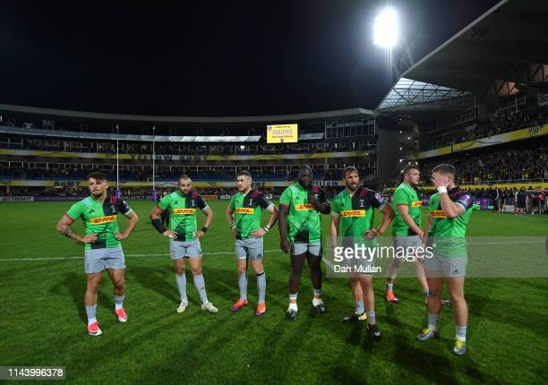 The Harlequins players stand dejected following their loss during the European Challenge Cup Semi Final match between Clermont Auvergne and...