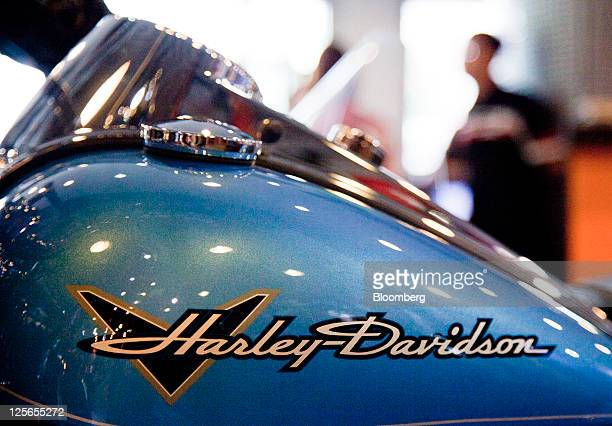 The Harley Davidson Inc logo is displayed on a motorcycle at a dealership in Shanghai China on Friday Aug 12 2011 Across China almost 100 cities have...
