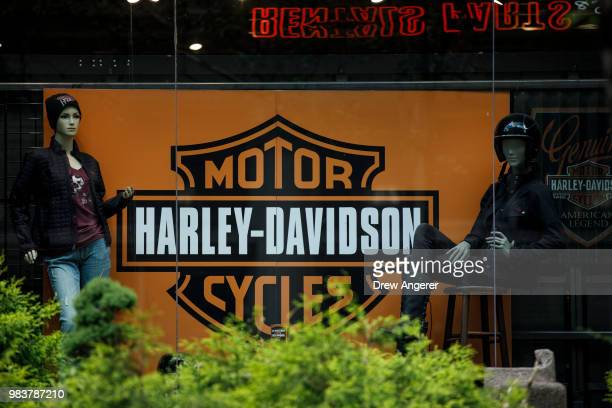 The Harley Davidson logo is displayed in a window of HarleyDavidson of New York City store June 25 2018 in New York City The American motorcycle...