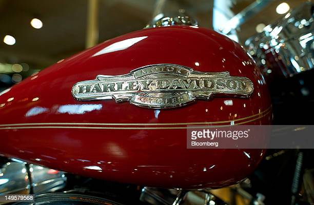 The HarleyDavidson Inc logo is displayed on a gas tank of a Road King motorcycle at the Dudley Perkins Co dealership in South San Francisco...