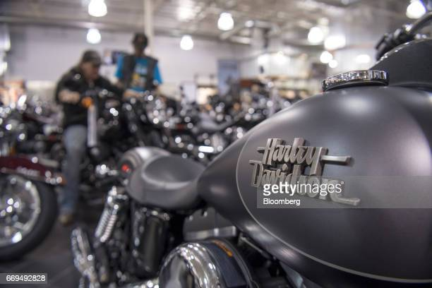 The HarleyDavidson Inc logo is seen on the fuel tank of a motorcycle on display at the Oakland HarleyDavidson dealership in Oakland California US on...