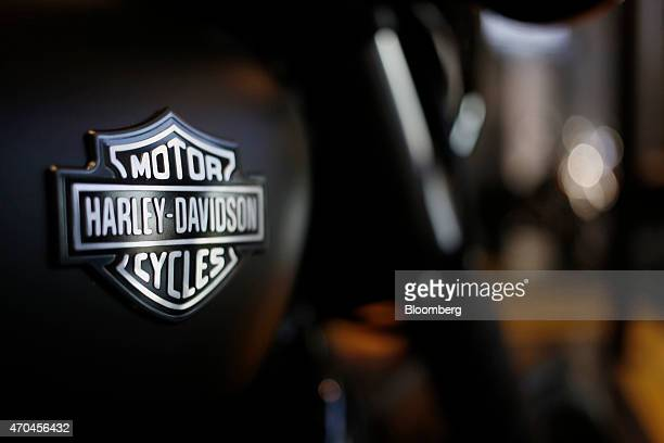 The HarleyDavidson logo is seen on a display motorcycle inside the tour center at the HarleyDavidson Vehicle and Powertrain Operations factory in...