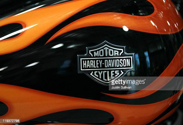 The HarleyDavidson logo is seen on the gas tank of a brand new motorcycle at Oakland HarleyDavidson on July 19 2011 in Oakland California Motorcycle...