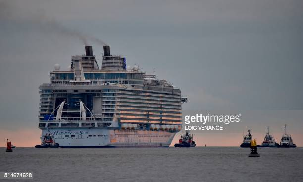 The Harmony of the Seas cruise ship leaves the STX shipyard of SaintNazaire western France for a threeday offshore test on March 10 2016 With a...