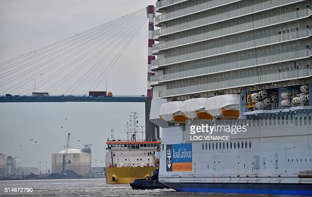 The Harmony of the Seas cruise ship passes by the SaintNazaire's bridge as it leaves the STX shipyard of SaintNazaire western France for a threeday...