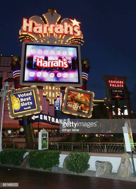 The Harrah's Las Vegas and Caesars Palace marquees are seen on the Strip June 27 2005 in Las Vegas Nevada Harrah's Entertainment Inccompleted its $9...