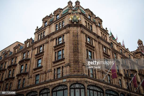The Harrods name is illuminated in lights on the front of the department store in Knightsbridge on November 29 2017 in London England The American...